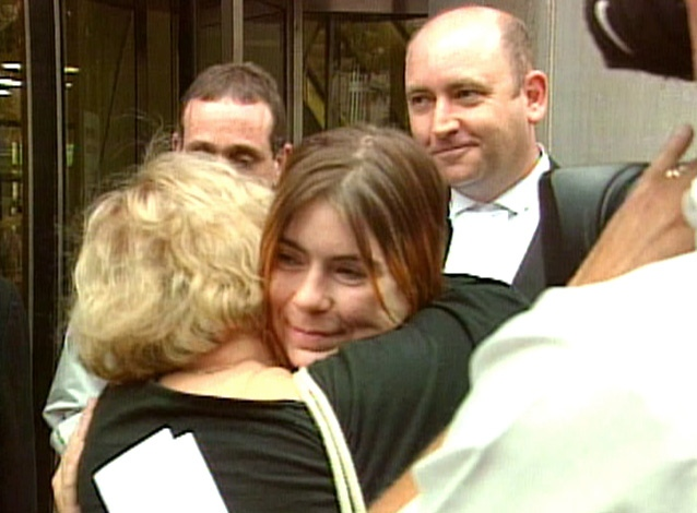 Nicole Kish gets a hug, as her lawyer looks on, after being released on bail.