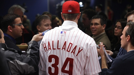 New Philadelphia Phillies pitcher Roy Halladay speaks to members of the media during a baseball news conference in Philadelphia, on Wednesday, Dec. 16, 2009. (AP / Matt Rourke)