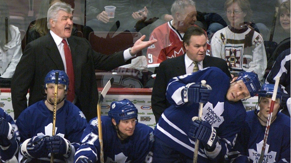 Toronto Maple Leafs GM and coach Pat Quinn, left, shows his displeasure with the referee as he stands beside assistant coach Rick Ley during NHL action against the Vancouver Canucks in Vancouver Saturday, March 16, 2003. (Chuck Stoody / THE CANADIAN PRESS)