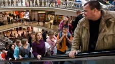 Thousands of people line all five levels of the Eaton Centre while doing some last minute Christmas shopping in Toronto, Wednesday, Dec. 23, 2009. (Darren Calabrese / THE CANADIAN PRESS)