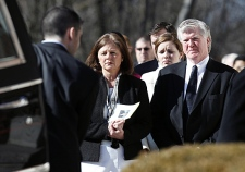 President and general manager of the Toronto Maple Leafs Brian Burke, right, and his first wife Kerry, left, watch as the casket of their son Brendan is taken from the hearse into a memorial service in Canton, Mass. on Tuesday, Feb. 9, 2010. (AP Photo/Michael Dwyer)