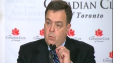 Finance Minister Dwight Duncan speaks to reporters on Friday, March 5, 2010.