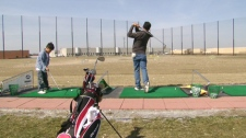 Some people used the summer-like weather to hit the driving range on Friday, April 2, 2010.