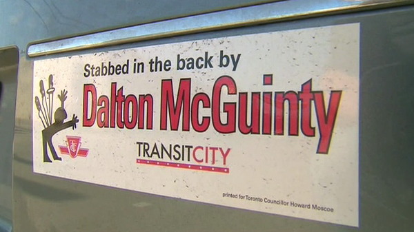 The bumper sticker accuses Premier Dalton McGuinty of stabbing Toronto in the back by delaying some Transit City funding.
