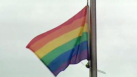 The pride flag flies at City Hall.