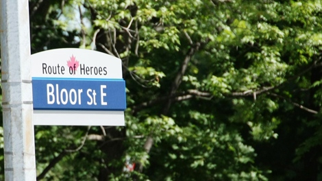"A man takes a photo of a new ""Route of Heroes"" street sign in Toronto, Monday, June 7, 2010.  (Colin Perkel / THE CANADIAN PRESS)"