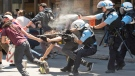 <b>Quebec student protests escalate, disrupt Montreal tourism</b><br><br>Police use pepper spray and fight with protesters during an arrest on St. Catharines street near the Montreal Grand Prix festival area, Sunday, June 10, 2012. As the warm weather set in, student protests escalated to a new degree of intensity in Montreal, even disrupting tourism and impacting local businesses negatively. (Peter McCabe/ THE CANADIAN PRESS)
