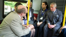 Prince Charles rides a city bus with community organization leaders n Toronto, on Tuesday, May 22, 2012. (Paul Chiasson / THE CANADIAN PRESS)