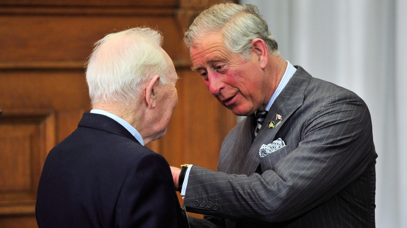 Prince Charles presents a Queen's Diamond Jubilee Medal to Lou Wise in Toronto on Tuesday, May 22, 2012. (Paul Chiasson / THE CANADIAN PRESS)