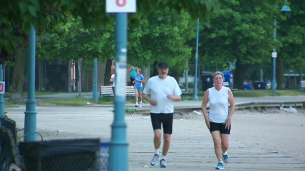 Joggers go for an early-morning run to beat the heat in Toronto ahead of possible record temperatures on Friday, May 25, 2012.