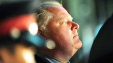 Toronto Mayor Rob Ford watches the activity outside the Eaton Centre in Toronto, Saturday, June 2, 2012. (Victor Biro / THE CANADIAN PRESS)