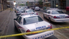 Dozens of police cars set up outside the Eaton Centre shopping mall in Toronto, Saturday, June 2, 2012. (John Chidley-Hill /  THE CANADIAN PRESS)
