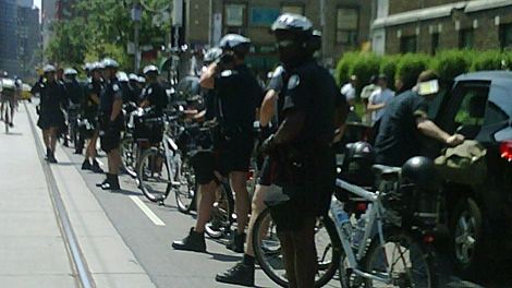 Toronto Police form a line on Carlton Street in advance of a protest on Friday, June 25, 2010. (Naomi Parness/CTV Toronto)