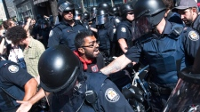 Activists and protesters clash with police while marching along the streets of downtown Toronto during the G8/G20 Summits on Friday, June 25, 2010. (Nathan Denette / THE CANADIAN PRESS)