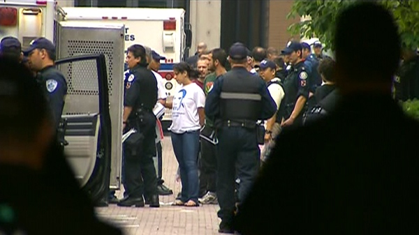 Police move in and make arrests during a massive morning raid near Spadina and College in downtown Toronto, Sunday, June 27, 2010.