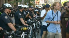 Protesters gathered outside police headquarters on College Street in Toronto, Monday, June 28, 2010.