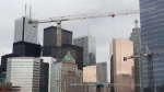 The Toronto skyline is seen behind construction cranes in Toronto on Saturday, February 4, 2012. (The Canadian Press/Pawel Dwulit)