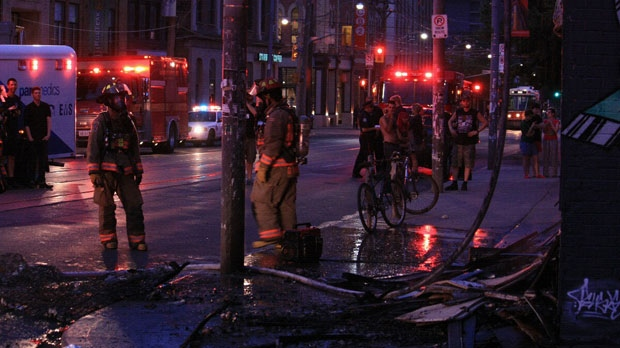 Firefighters survey scene of a suspected arson on Bathurst Street in the early morning hours of June 27, 2012. (Tom Stefanac/CTV News)