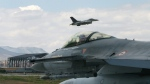 In this June 15, 2009 file photo, a Turkish F-16 prepares to taxi while another one takes off during Anatolian Eagle exercise at 3rd Main Jet Air Base near the central Anatolian city of Konya, Turkey. (AP / Selcan Hacaoglu)