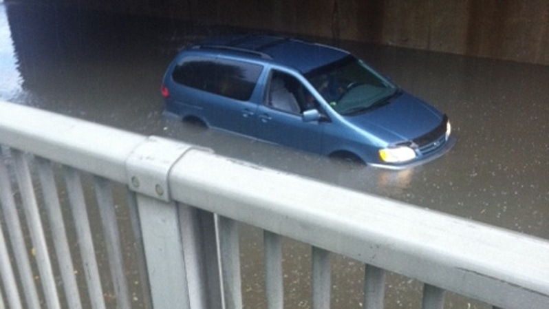 A van is stuck in flood waters under a bridge in Scarborough on July 15, 2012. (Photo courtesy: Shannah Shawna)