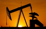 A pump jack is silhouetted against the setting sun in Oklahoma City, Tuesday, March 22, 2012. (AP / Sue Ogrocki)