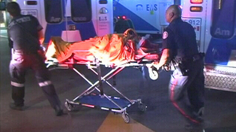 Paramedics wheel a shooting victim into Sunnybrook Hospital on Monday, July 16, 2012.