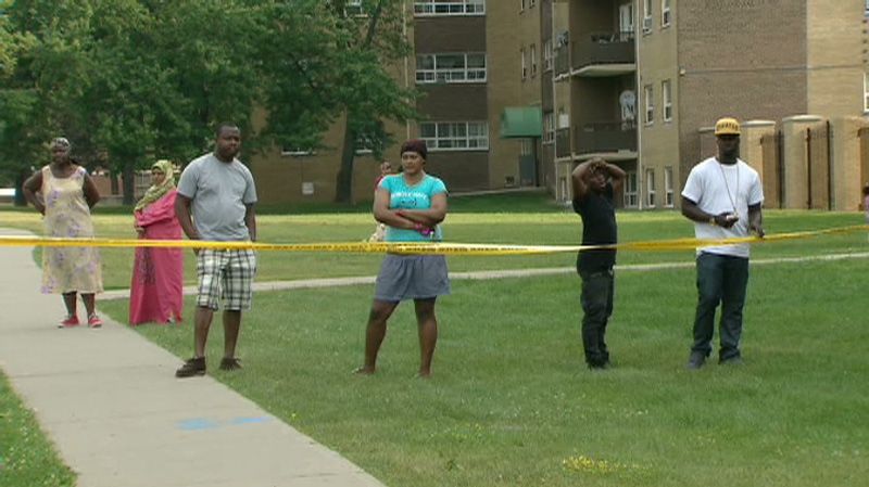 Community members near Danzig Street are seen in this image in Scarborough on Tuesday, July 17, 2012.