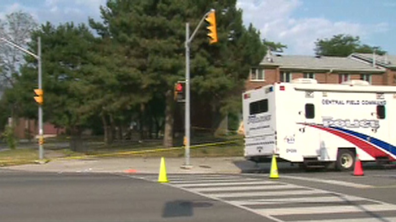 Police investigate the scene of a fatal shooting in Scarborough on Tuesday, July 17, 2012.