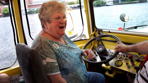 Bus monitor Karen Klein, of Greece, N.Y., sits at the controls of a duck boat, an amphibious tourism vehicle, while floating in the Charles River, in Boston, Thursday, June 28, 2012. (AP Photo/Steven Senne)