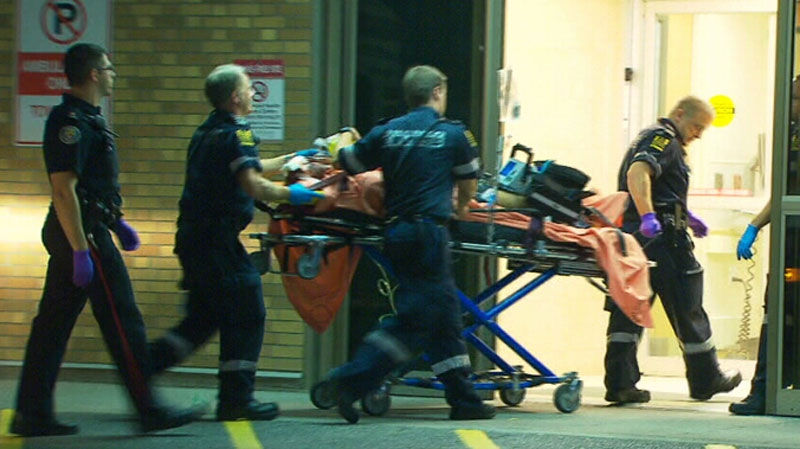 A Toronto EMS crew brings a victim of a shooting near Jane and Finch into Sunnybrook Hospital in Toronto, Friday, July 20, 2012.