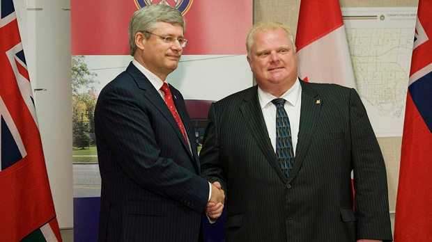 Prime Minister Stephen Harper shakes hands with Toronto Mayor Rob Ford at 43 Division in Toronto on Tuesday, July 24, 2012. (Aaron Vincent Elkaim / THE CANADIAN PRESS)