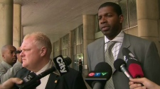 Coun. Rob Ford (left) and Pastor Wendell Brereton speak to reporters outside city hall on Wednesday, Aug. 4, 2010.