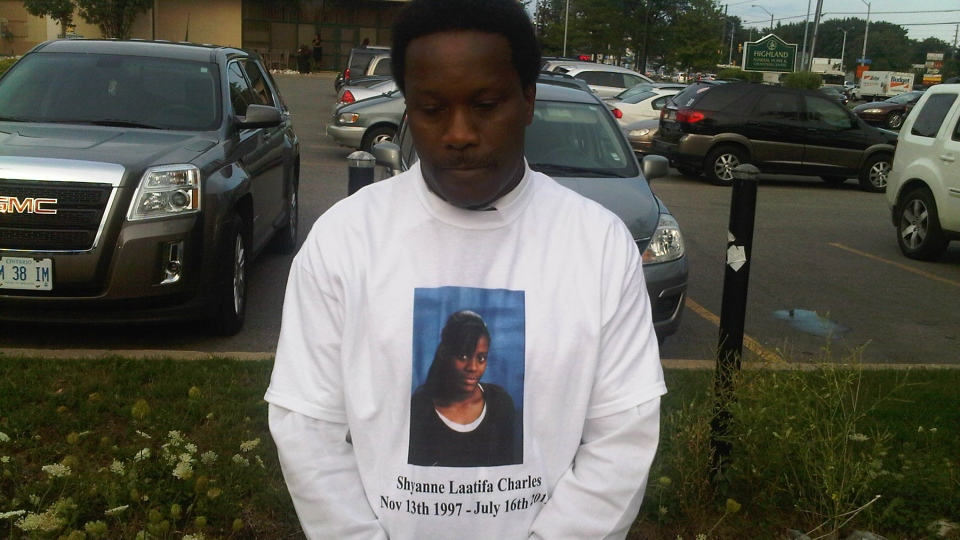Robert Marecheau, uncle to slain teen Shyanne Charles, wears a T-shirt with Charles' image at a visitation in Toronto on Friday, July 27, 2012. (CTV/Ashley Rowe)