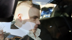 Michael Rafferty is transported from the London, Ont., courthouse in the back of police cruiser Wednesday, March, 14, 2012. (Dave Chidley / THE CANADIAN PRESS)