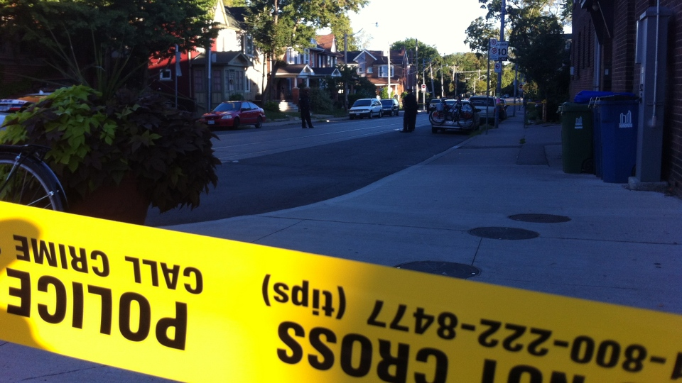 Police rope off a section of St. Clair Avenue after a cyclist was killed when he fell off his bike on Monday, Aug. 6, 2012. CTV/Scott Lightfoot