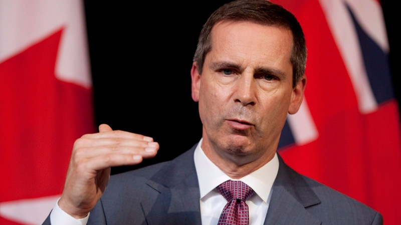 Premier Dalton McGuinty speaks at a press conference following a meeting at Queen's Park on Monday, July 23, 2012. (Michelle Siu / THE CANADIAN PRESS)
