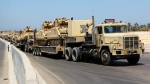 Army trucks carry Egyptian military tanks in El Arish, Egypt's northern Sinai Peninsula, Thursday, Aug. 9, 2012. (AP)
