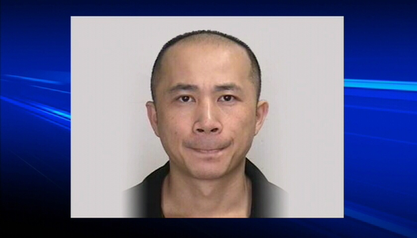 Police say 35-year-old Kai-Guo Huang was originally arrested Aug. 7 in the city's northeast and charged with driving over the legal blood-alcohol limit.