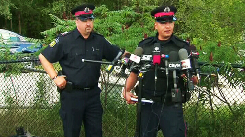 Cst. George Tudos and Sgt Pete Brandwood update reporters on the discovery of human hands in the Credit River in Mississauga, Ont., on Friday, Aug. 17, 2012.