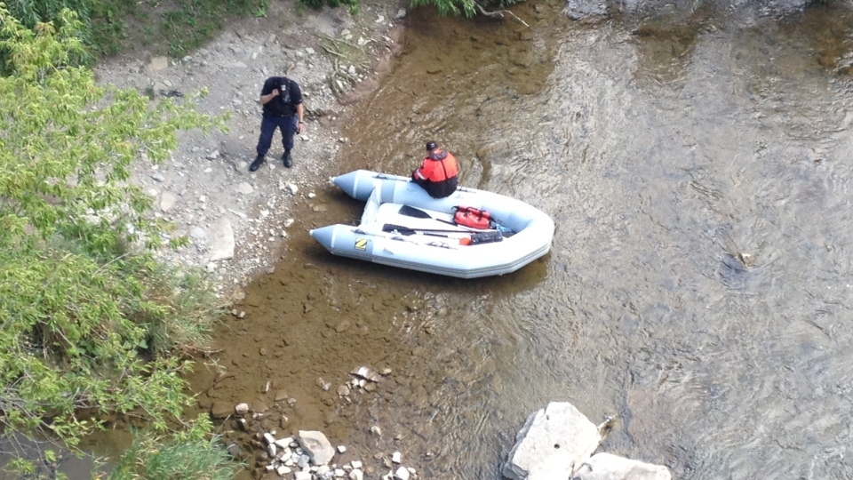 Police search the shores of the Credit River after the discovery of human hands in Mississauga, Ont., on Friday, Aug. 17, 2012. (Cristina Tenaglia / CTV News)