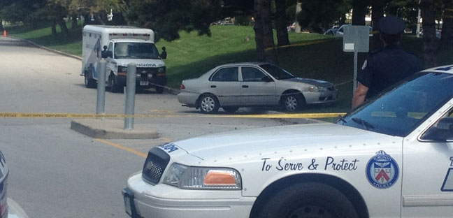 Police cruisers are shown at the scene of a serious accident outside the Ontario Science Centre. (Katie Simpson/CP24.com)