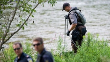 A Police search dog unit searches Credit River in Hewick Meadows Park in  Mississauga, Ont