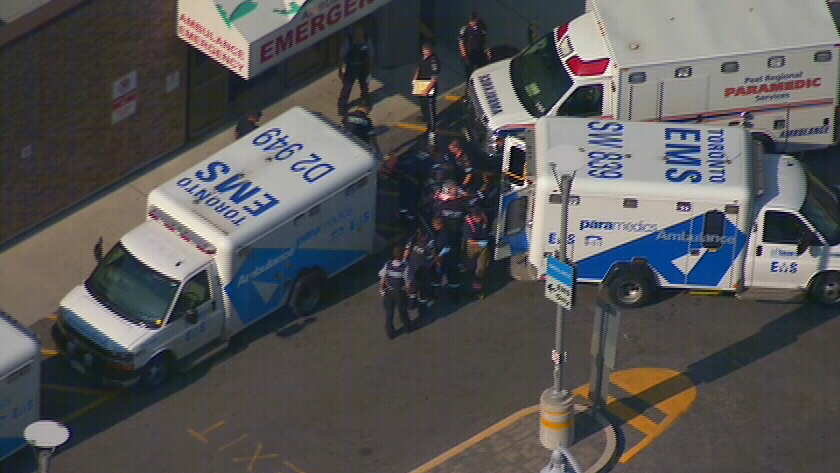 A cyclist who was struck by a vehicle is brought to Sunnybrook hospital in Toronto on Thursday, Aug. 23, 2012.