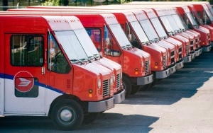 Canada Post vehicles sit outside a sorting depot in the Ville St-Laurent borough of Montreal, in this June 6, 2011 photo. (Graham Hughes / THE CANADIAN PRESS)