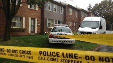 Police are shown at the townhouse of Chunqui Jiang in Scarborough, Ont.