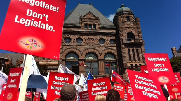 Teachers rally outside on the front lawn of the Ontario legislature at Queen's Park in Toronto, Tuesday, Aug. 28, 2012. (Colin D'Mello / CTV News)