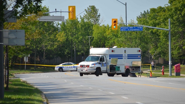 Peel Regional Police seal off the area around Winston Churchill Blvd and Unity Drive in Mississauga, Friday, Aug. 31, 2012.