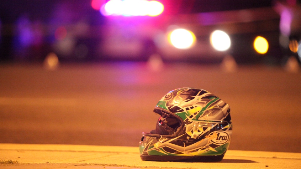 A helmet sits on the sidewalk after a motorcyclist was killed in a collision in Mississauga on Friday, Aug. 31, 2012. (Tom Podolec/CTV Toronto)