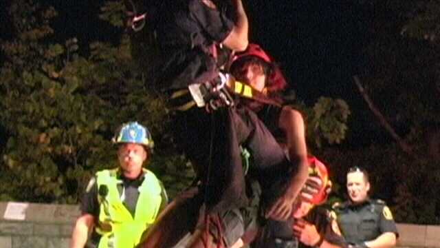 A young male is shown being rescued by emergency officials after becoming stranded at the Niagara gorge in Niagara Falls, Ont. on Sunday, Sept. 2, 2012.