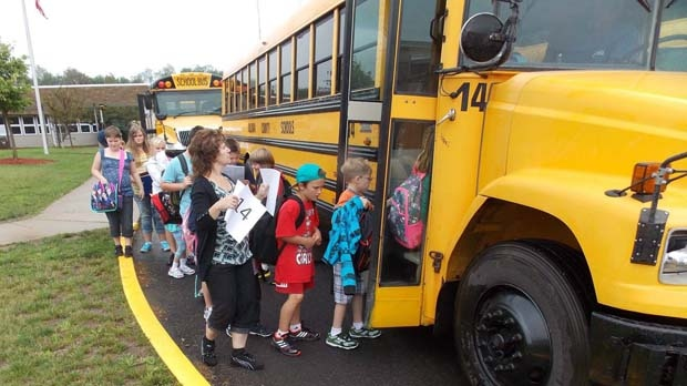 Students board a bus in Laport, Pa., on Monday, Aug. 20, 2012. (AP Photo/The Daily Review, James Loewenstein)